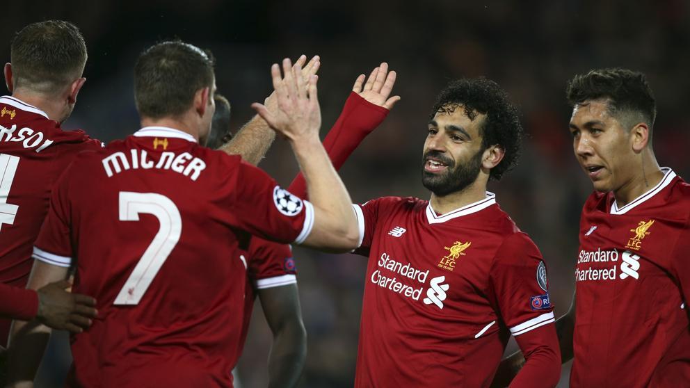 Los jugadores del Liverpool celebrando un gol en Champions League.
