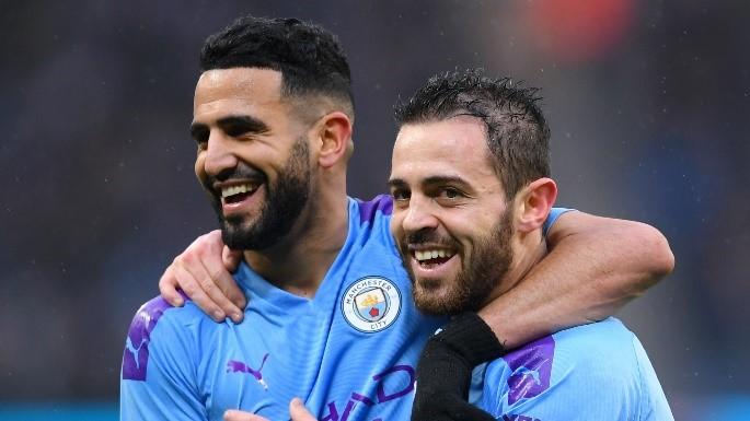 Mahrez y Bernardo Silva celebrando un gol con el Manchester City. Fuente: Goal.com