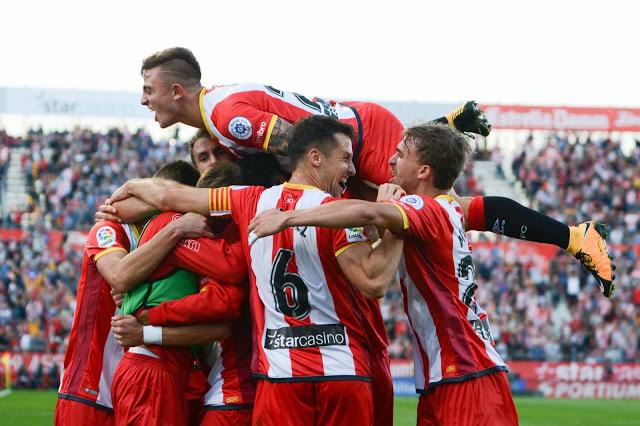 Los jugadores del Girona FC celebrando el gol de la victoria contra el Real Madrid en Montilivi (2-1). Fuente: Girona FC
