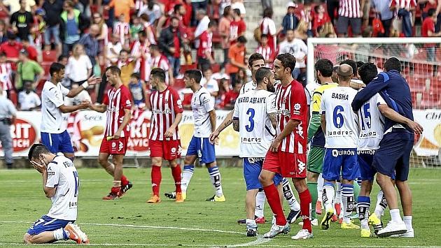 Jugadores del Girona desolados tras empatar contra el Lugo en la última jornada. Fuente: Marca